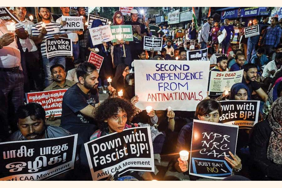 Protesters raise slogans at a midnight candle-light demonstration against the CAA during the New Year celebrations in Chennai, India.   —Photo:  Courtesy PTI via the Internet