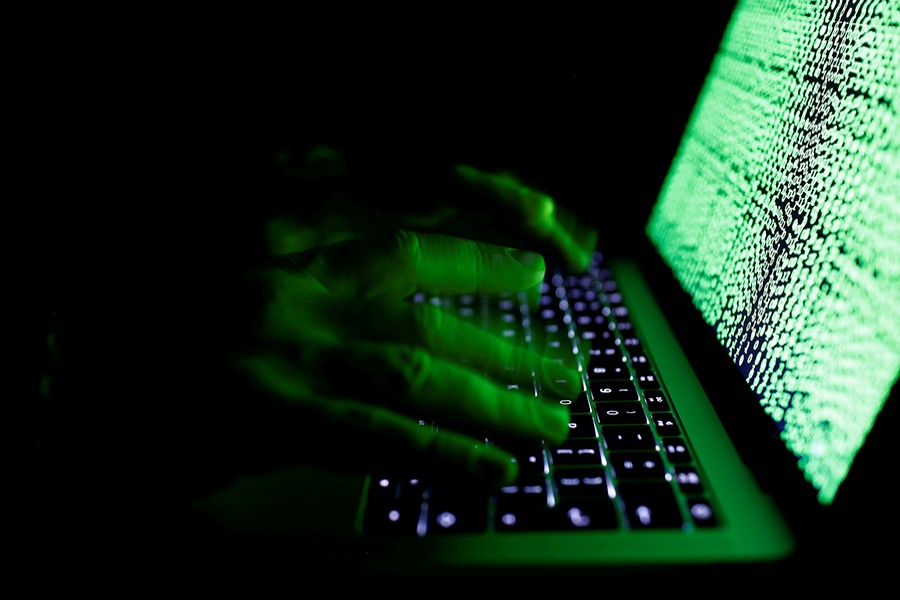 A man types on a computer keyboard in front of the displayed cyber code in this illustration picture taken on March 1, 2017 — Reuters/Files