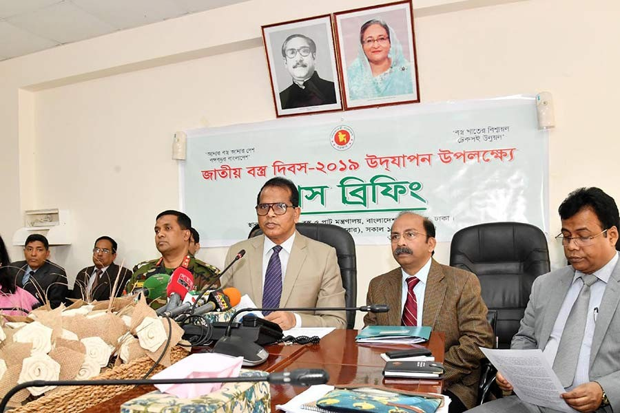 Secretary of Textiles and Jute Ministry Lokman Hossain Mia addressing a press conference at the secretariat on Tuesday. -PID Photo