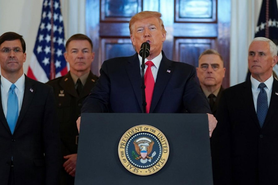 US President Donald Trump delivering a statement about Iran flanked by US Secretary of Defence Mark Esper, Vice President Mike Pence and military leaders in the Grand Foyer at the White House in Washington on Wednesday. -Reuters Photo