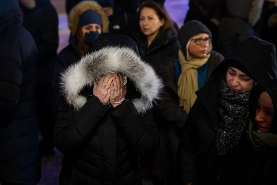 A woman mourns outside the Alberta Legislature Building in Edmonton, Alberta, Wednesday, January 8, 2020, during a vigil for those killed after a Ukrainian passenger jet crashed, killing at least 63 Canadians, just minutes after taking off from Iran's capital — Codie McLachlan/The Canadian Press via AP
