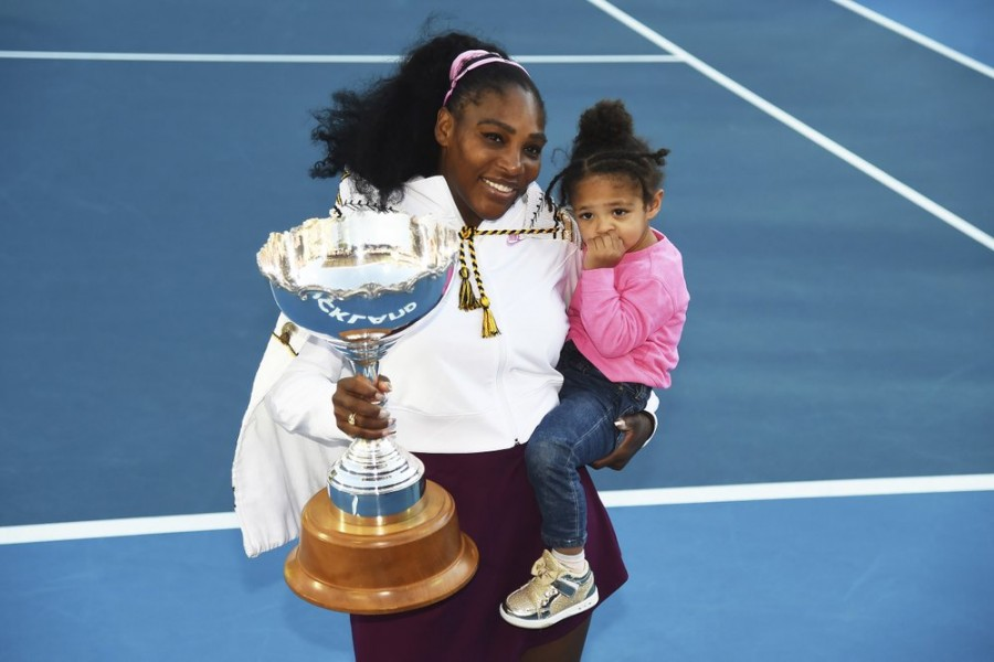 Serena Williams from the United States with daughter Alexis Olympia Ohanian Jr. and the ASB trophy after winning her singles finals match against United States Jessica Pegula at the ASB Classic in Auckland, New Zealand, Sunday, Jan 12, 2020. (Chris Symes/Photosport via AP)