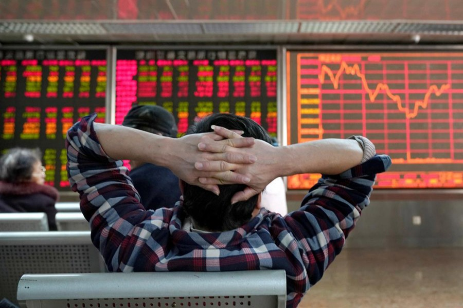 An investor looks at a stock quotation board at a brokerage office in Beijing, China, January 03, 2020. Reuters/Files