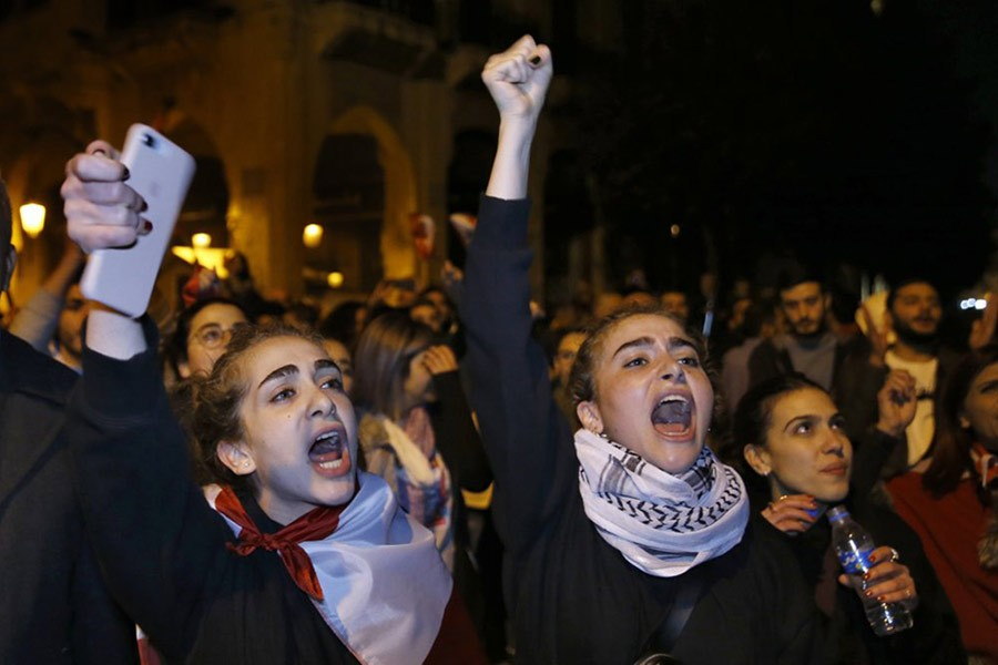 Protesters chanting slogans during protests against the Lebanese political class, in downtown Beirut, Lebanon in last month. -AP Photo