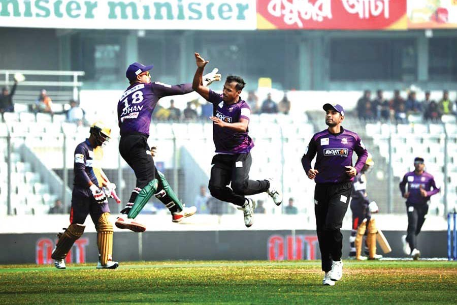 Chattogram Challengers' Rubel Hossain celebrating with teammate Nurul Hasan Sohan after getting the wicket of Dhaka Platoon's Tamim Iqbal during the BBPL match at Sher-e-Bangla National Cricket Stadium in the city on Monday— BCB