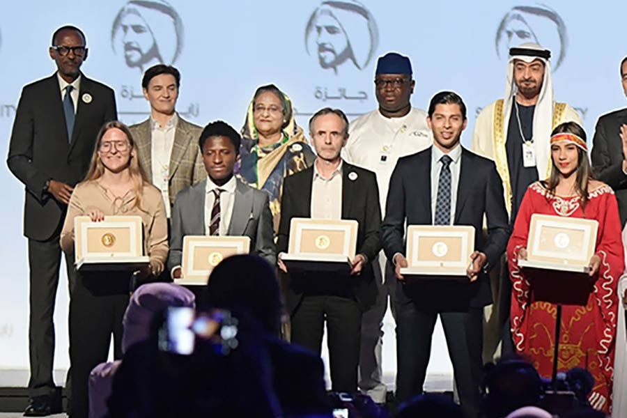 Prime minister Sheikh Hasina and other leaders pose with the winners of Zayed Sustainability Prize at ICC Hall of Abu Dhabi National Exhibition on January 13, 2020.         — Photo: PID