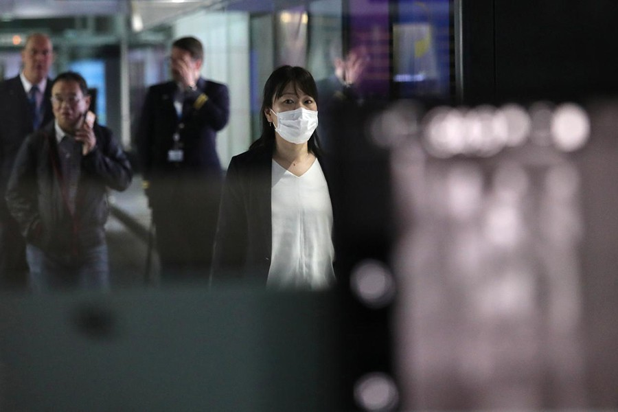 A woman with mask passes by thermal screening point at international arrival terminal of Kuala Lumpur International Airport in Sepang, Malaysia on January 21, 2020 — Reuters photo