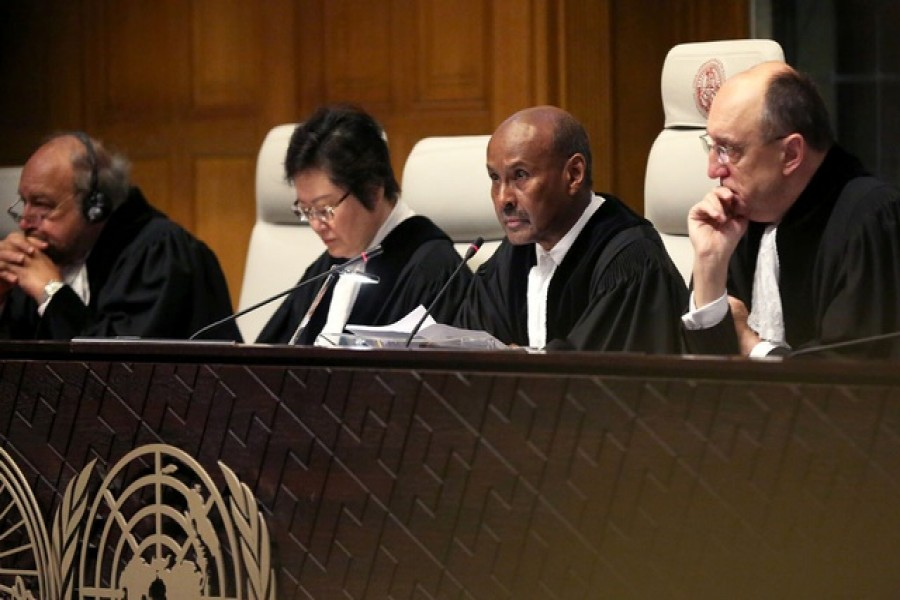Judge Abdulqawi Ahmed Yusuf is pictured during the ruling in a case filed by Gambia against Myanmar alleging genocide against the minority Muslim Rohingya population, at the International Court of Justice (ICJ) in The Hague, Netherlands Jan 23, 2020. REUTERS