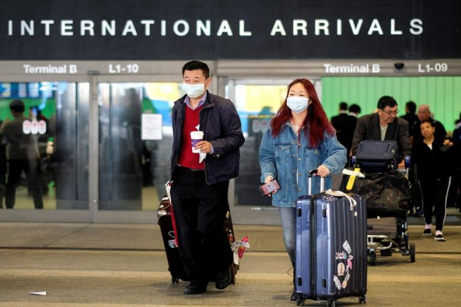 Passengers leave LAX after arriving from Shanghai, China, after a positive case of the coronavirus was announced in the Orange County suburb of Los Angeles, California, US on January 26, 2020 — Reuters photo
