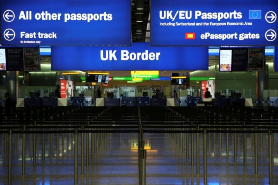 UK Border control is seen in Terminal 2 at Heathrow Airport in London June 4, 2014. Reuters/Files