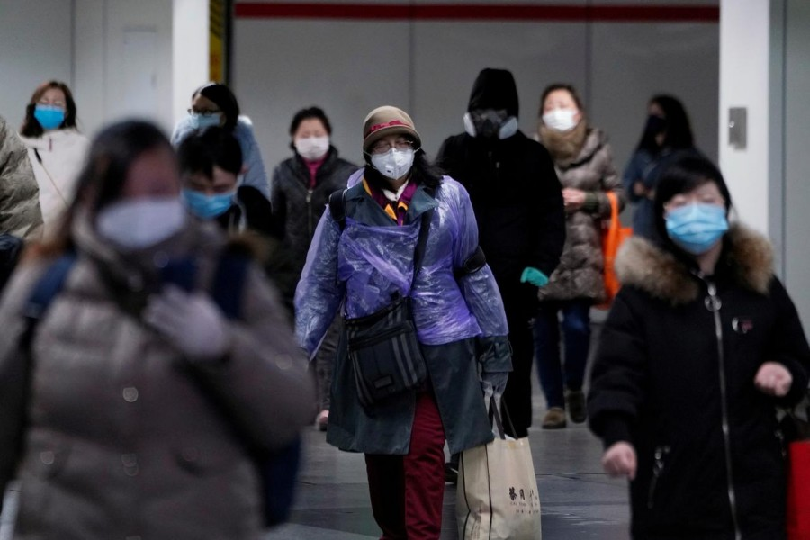 People wearing face masks walk inside a subway station, as the country is hit by an outbreak of the novel coronavirus, in Shanghai, China, February 17, 2020. Reuters