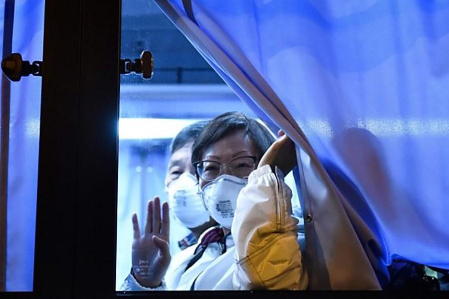 Americans from quarantined coronavirus-hit cruise ship leave Japan