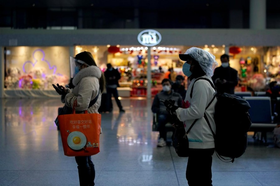 Travellers with face masks and shields are seen at the Shanghai Hongqiao Railway Station on the last day of the Spring Festival travel rush, as the country is hit by an outbreak of the novel coronavirus, in Shanghai, China, February 18, 2020. Reuters