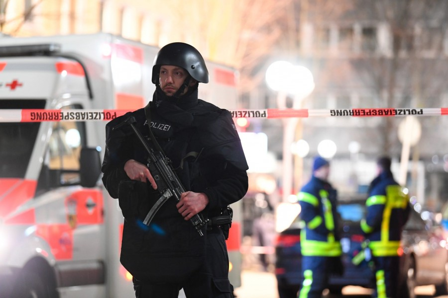 Police officers secure an area after a shooting in Hanau near Frankfurt, Germany, February 20, 2020. Reuters