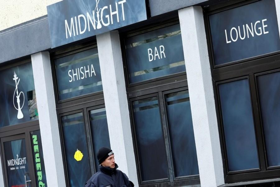 A police officer walks outside the Midnight Shisha bar after a shooting in Hanau, near Frankfurt, Germany, February 20, 2020. Reuters