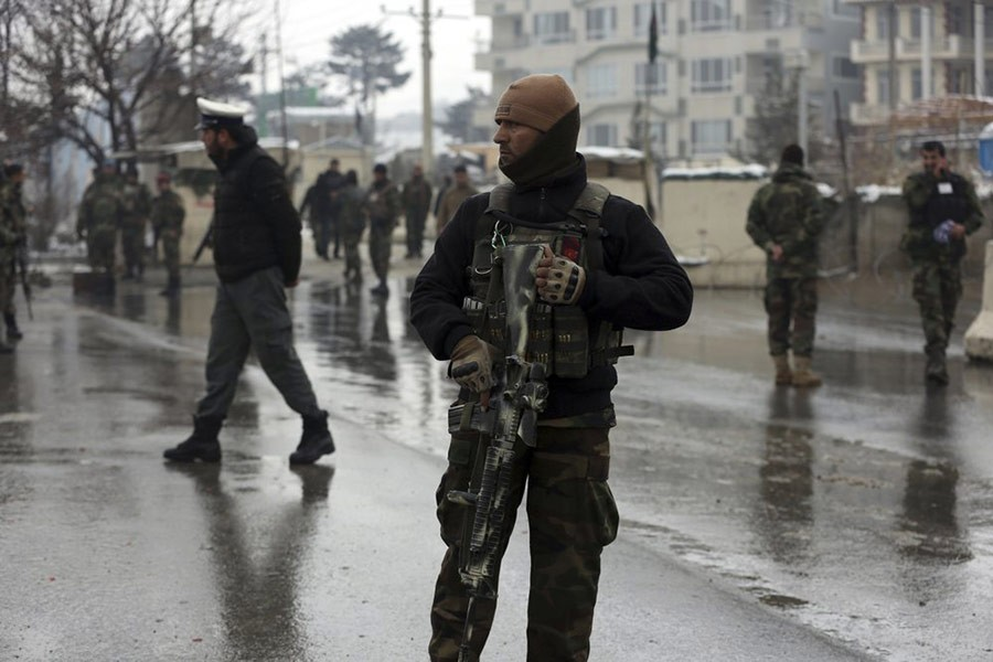Afghanistan security forces standing guard at the site of suicide attack near the military academy in Kabul, Afghanistan on February 11. -AP file photo