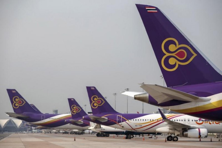 FILE PHOTO: Thai Airways aircraft are parked on the tarmac at Bangkok's Suvarnabhumi International Airport March 27, 2015. REUTERS/Athit Perawongmetha