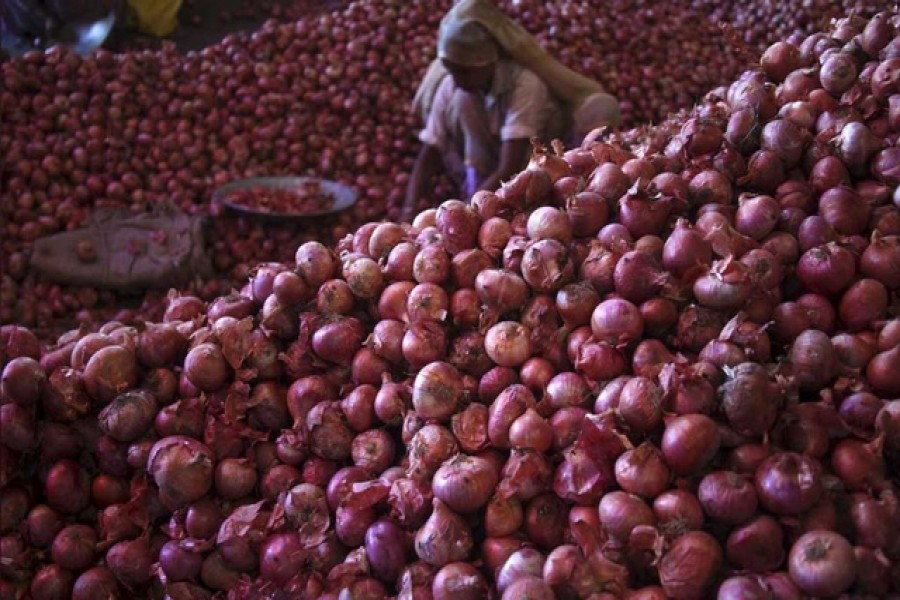 A worker sorts onions at a wholesale vegetable market in Chandigarh, India, July 24, 2015. Reuters/Files