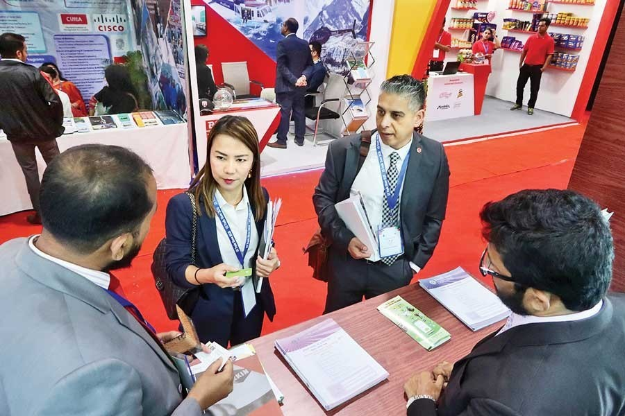 Visitors making inquiry at the US Trade Show 2020 at a city hotel on Thursday