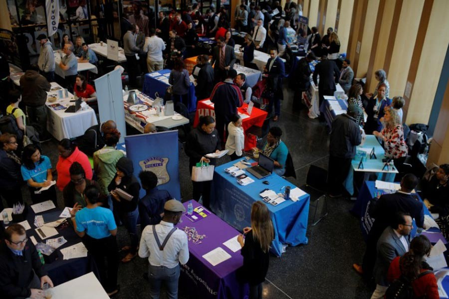 A Reuters file photo shows American job seekers speaking with potential employers at a City of Boston Neighborhood Career Fair on May Day in Boston, Massachusetts of USA in 2017. -Reuters Photo