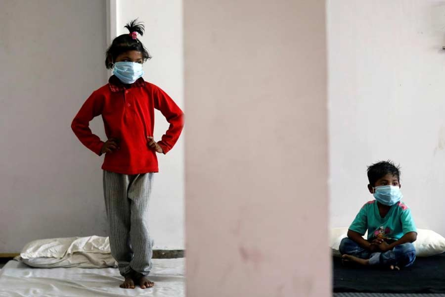 Children of migrant workers staying a sports complex turned into a shelter, during a 21-day nationwide lockdown to slow the spread of the coronavirus disease (COVID-19), in New Delhi, India on Saturday. –Reuters Photo