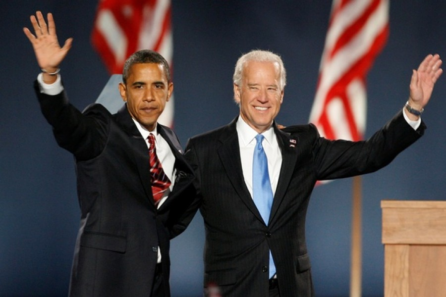 FILE PHOTO: US President-elect Senator Barack Obama and Vice President-elect Senator Joe Biden wave to supporters after speaking at Obama's election night rally after being declared the winner of the 2008 U.S. Presidential election in Chicago, US November 4, 2008. Reuters