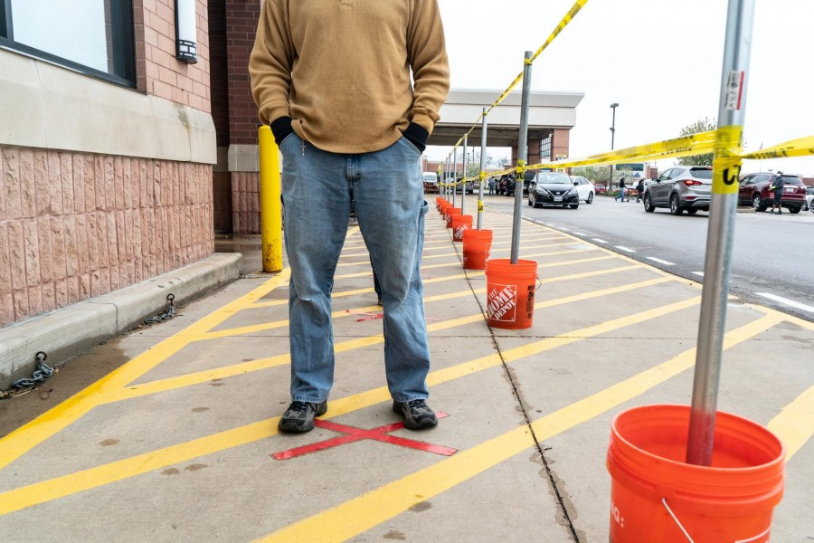 A shopper lines up to enter a Home Depot building supplies store while practicing social distancing to help slow the spread of coronavirus disease (COVID-19) in north St. Louis, Missouri, US April 4, 2020. Picture taken April 4, 2020. REUTERS/Lawrence Bryant
