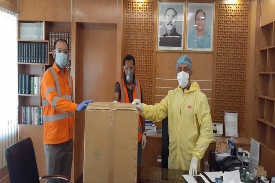 LafargeHolcim distributes food packets, masks