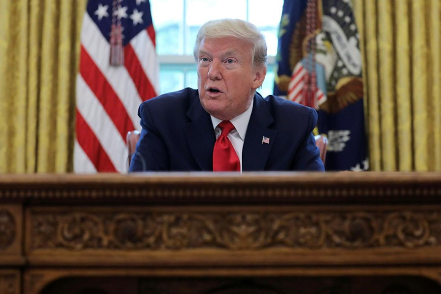 US President Donald Trump answers questions during an interview with Reuters about the novel coronavirus (COVID-19) pandemic and other subjects in the Oval Office of the White House in Washington, US on April 29, 2020 — Reuters photo
