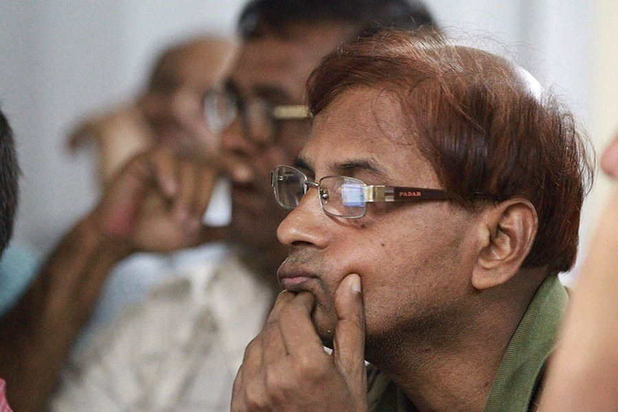 Investors monitoring stock price movements on computer screens at a brockerage house in Dhaka city. — FE/Files