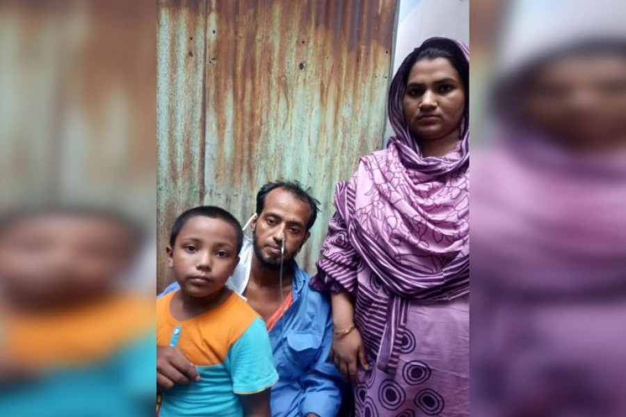 Sikdar Rana at home in Dhaka with his wife Moshumi Akhter, 27, and their six-year-old son Mahim — Courtesy of Dr Cynthia Goh via The Straits Times