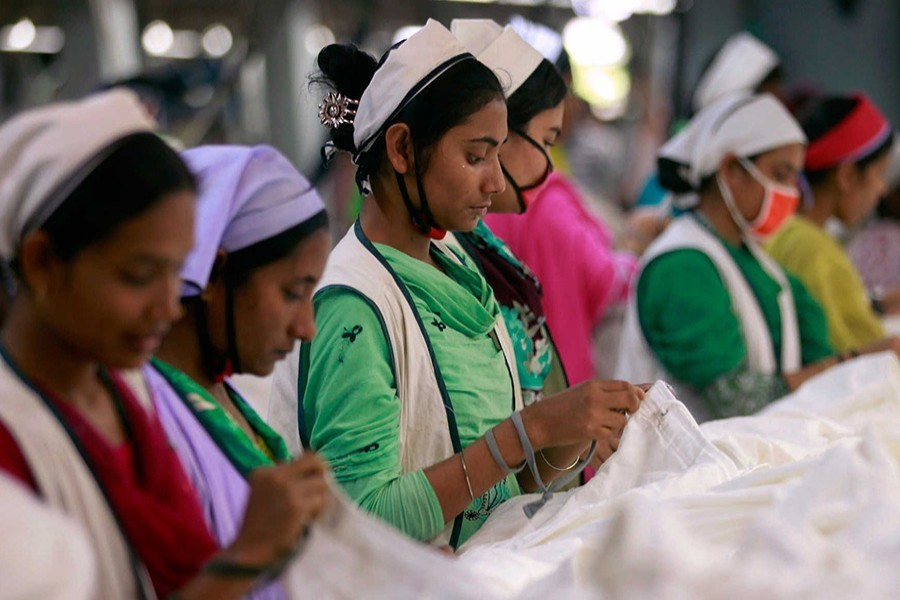 Women work at a garment factory inside the Dhaka Export Processing Zone (DEPZ) in Savar on April 11, 2013 — Reuters/Files