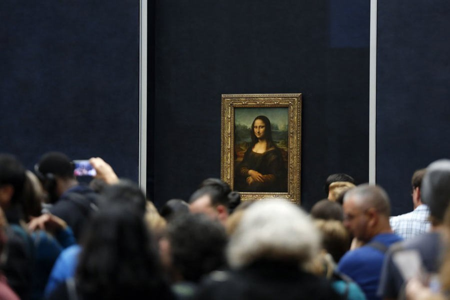 AP file photo shows, tourists waiting to see Leonardo da Vinci's painting Mona Lisa, at the Louvre museum, in Paris. –AP file photo