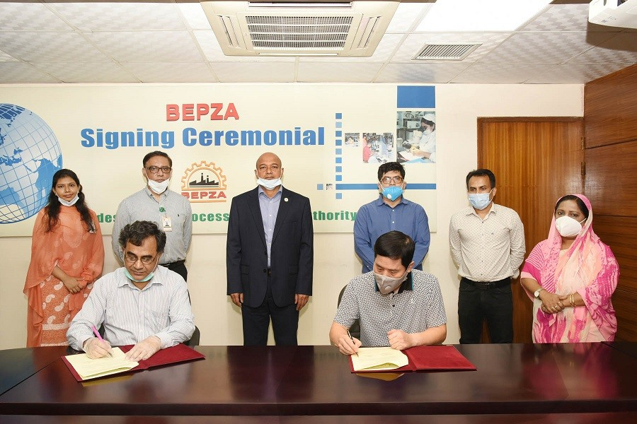 A view of a deal signing ceremony recently held in Dhaka between South Korea's Giant BD Co Ltd and Bangladesh Export Processing Zone (BEPZA). — Photo Courtesy: BEPZA