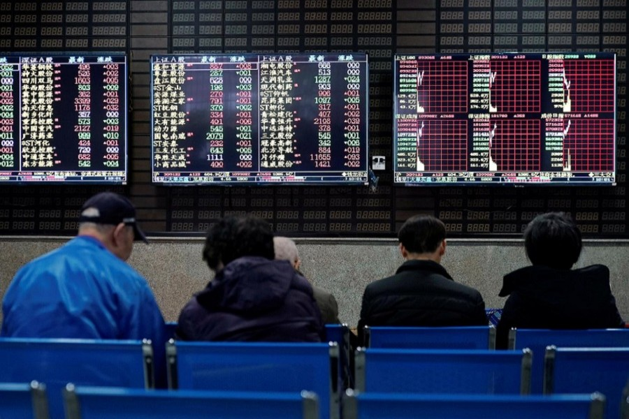 Investors look at screens showing stock information at a brokerage house in Shanghai, China, January 16, 2020. — Reuters/Files