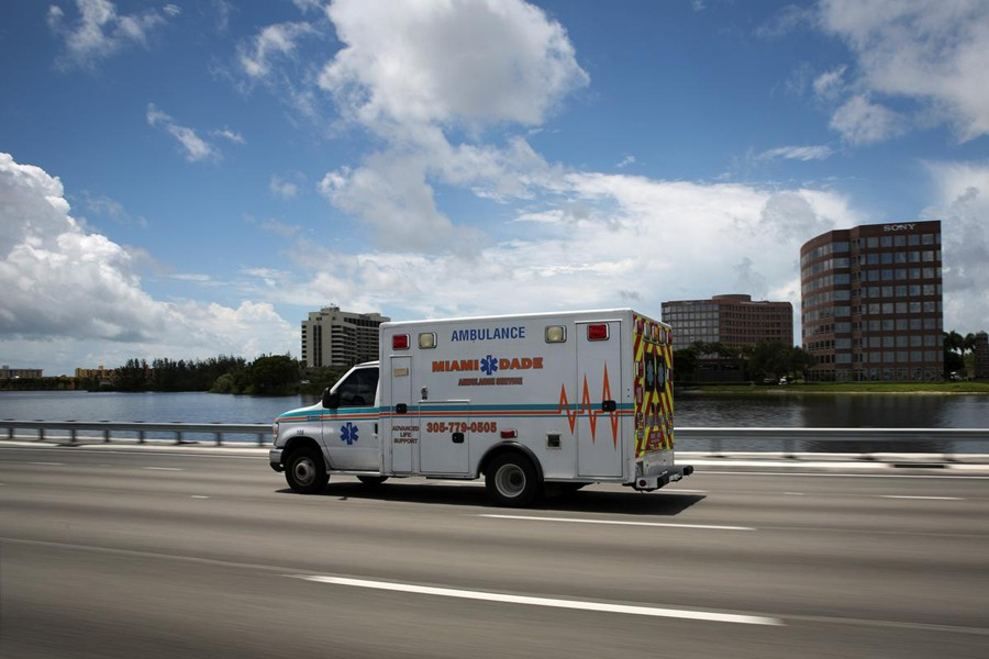 An ambulance is seen in a main highway, as Miami-Dade County eases some of the lockdown measures put in place during the coronavirus disease (Covid-19) outbreak, in Miami, Florida, US on June 18, 2020 — Reuters/Files