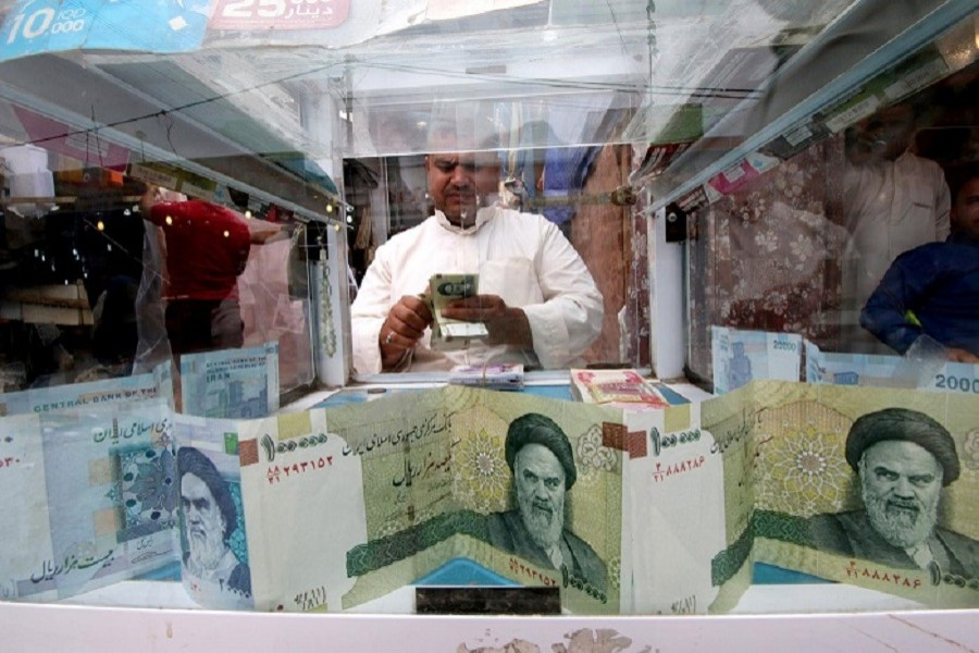 A man counts Iranian rials at a currency exchange shop, before the start of the US sanctions on Tehran, in Basra, Iraq, November 03, 2018 — Reuters/Files