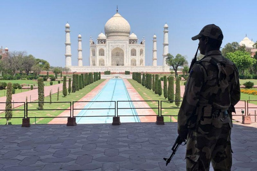 A member of Central Industrial Security Force (CISF) personnel stands guard inside the empty premises of the historic Taj Mahal during a 21-day nationwide lockdown to slow the spread of Covid-19, in Agra, India on April 2, 2020 — Reuters/Files