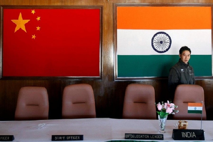 A man walks inside a conference room used for meetings between military commanders of China and India, at the Indian side of the Indo-China border at Bumla, in the northeastern Indian state of Arunachal Pradesh, November 11, 2009 — Reuters/Files