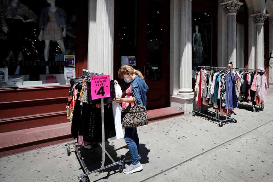 Shoppers browsing racks of clothes at a newly re-opened retail store along Broadway in lower Manhattan on the first day of the phase two re-opening of businesses following the outbreak of the coronavirus disease (COVID-19) in New York last month –Reuters Photo