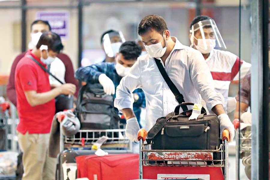 The Bangladeshis who were sent back from Italy arrive at the Hazrat Shahjalal International Airport in the city on Friday — Collected