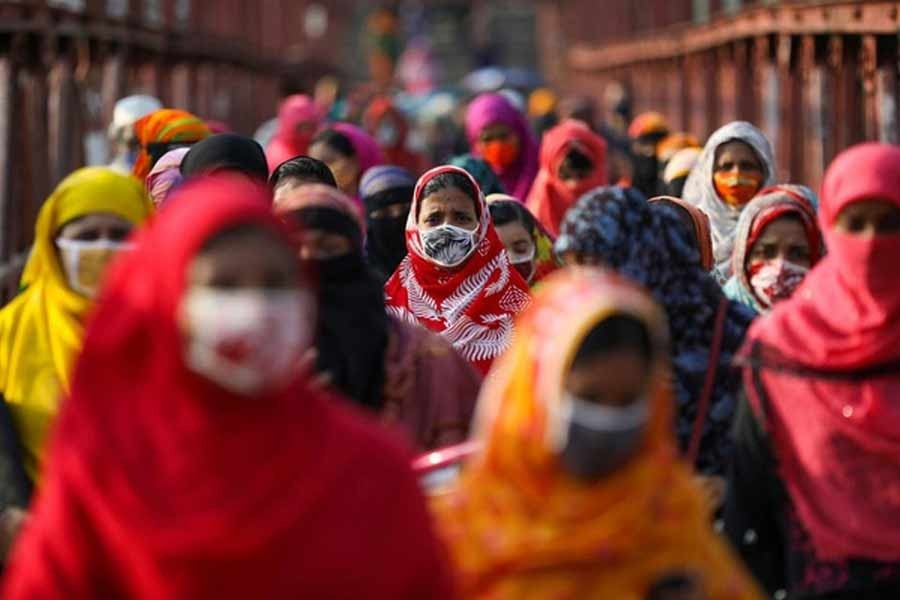 Garment workers return from a workplace as factories reopened after the government has eased the restrictions amid concerns over the coronavirus disease (COVID-19) outbreak in Dhaka, Bangladesh, May 04, 2020 — Reuters/Files