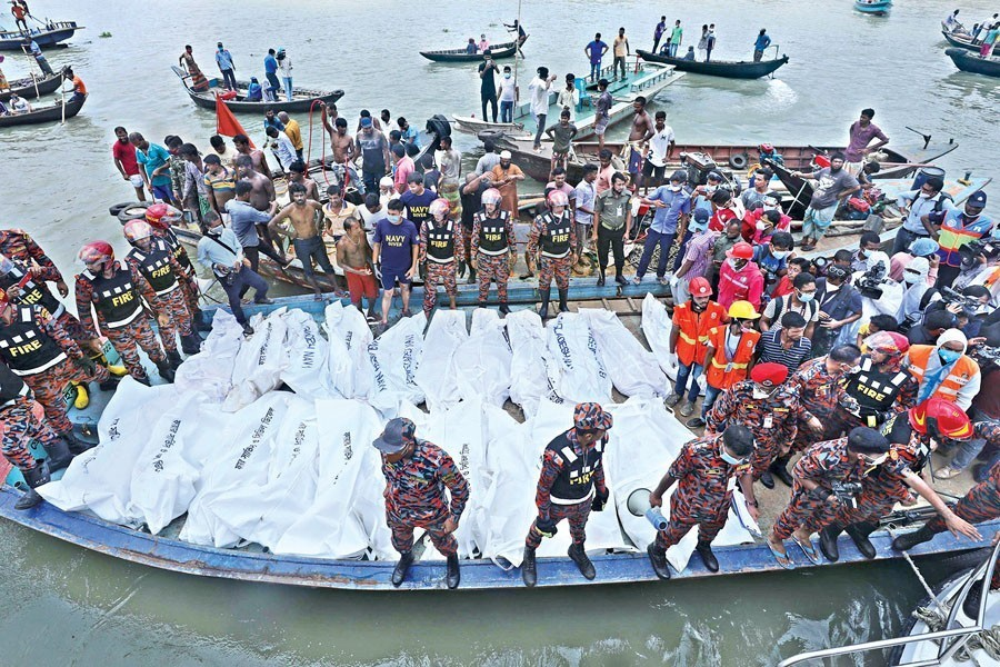 Bodies recovered by rescuers lying lined up after a launch sank in the Buriganga River at Dhaka's Shyambazar following a collision with another vessel - FE photo
