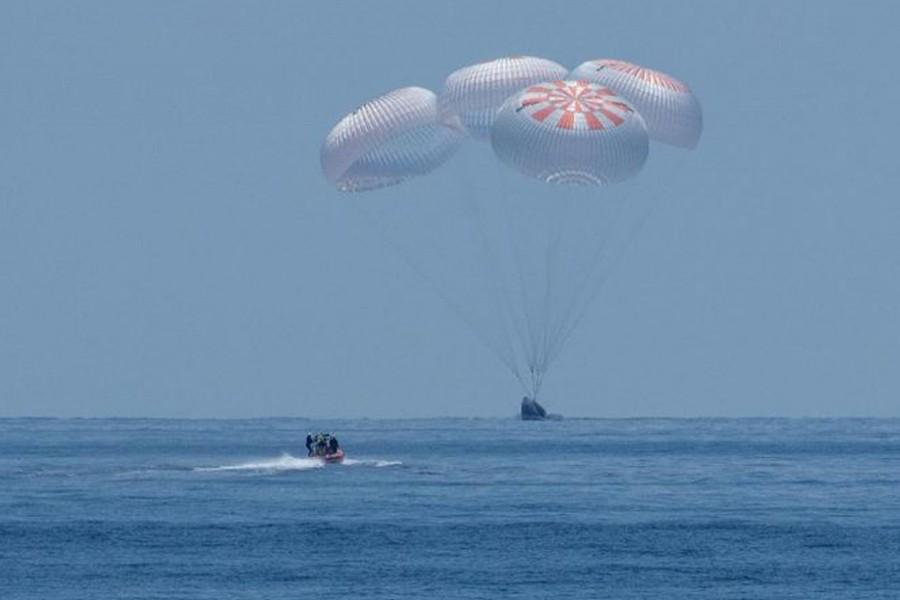 NASA astronauts make historic return to Earth