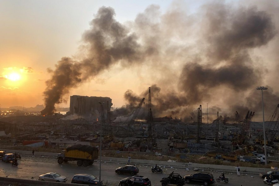 Smoke rises from the site of an explosion in Beirut, Lebanon August 4, 2020. REUTERS/Issam Abdallah