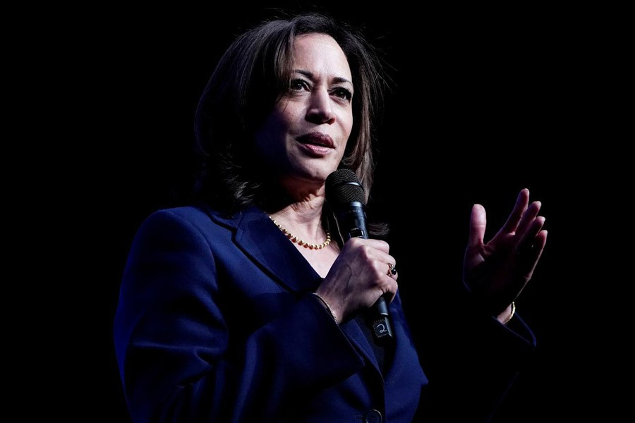 FILE PHOTO: Senator Kamala Harris, Joe Biden's selection as his running mate, appears on stage at a First in the West Event at the Bellagio Hotel in Las Vegas, Nevada, U.S., November 17, 2019. REUTERS/Carlo Allegri
