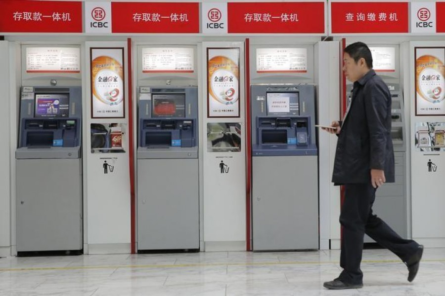A man walks past the ATMs of Industrial and Commercial Bank of China Ltd (ICBC) in Beijing — reuters/Files
