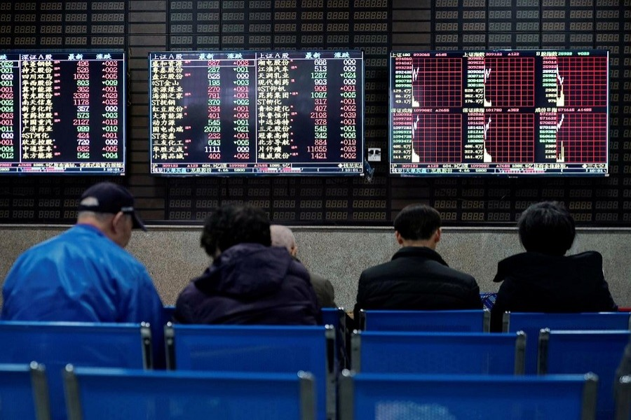 Investors look at screens showing stock information at a brokerage house in Shanghai, China January 16, 2020 — Reuters/Files