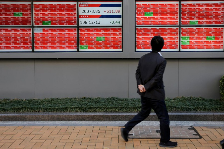 A man looks at an electronic board showing the Nikkei stock index outside a brokerage in Tokyo, Japan, January 07, 2019 — Reuters/Files