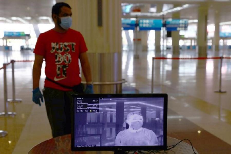 A man is seen through a thermal camera at Dubai International Airport amid the outbreak of the coronavirus disease (Covid-19) in Dubai, UAE, April 27, 2020 — Reuters/Files
